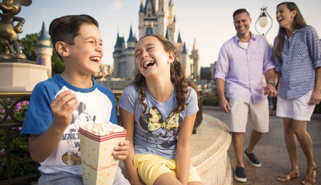 family enjoying the magic kingdom disney theme park