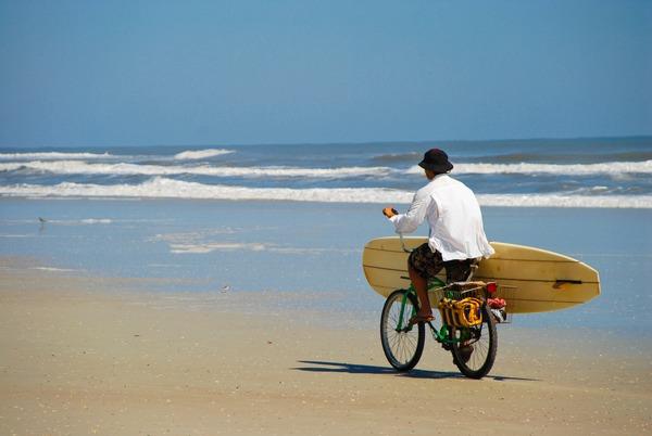 Surfer on a bike